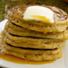 Whole Wheat Pancakes from Scratch - Wheat germ and whole wheat flour make these pancakes extra good for you. Perhaps you can be a little less guilty for having bacon too!
