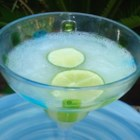 Daiquiri Cocktail - The daiquiri is believed to have originated in Cuba. Shake rum, lime juice, and simple syrup with ice and serve.