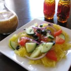 Refreshing Spaghetti Squash and Cucumber Salad - A simple lemon juice dressing coats spaghetti squash, cucumber, red onion, cherry tomatoes, and kalamata olives in this refreshing salad.