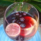Sangria Cocktail - Sangria is a Spanish wine punch that includes chopped fruit and sparkling water for a refreshing summertime cooler.