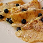 Simple Cottage Cheese Pancakes - Cottage cheese is the secret ingredient in these thin and delicate pancakes. Sprinkle with blueberries for extra color and flavor.