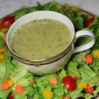 Delicious Poppy Seed Dressing - This tangy, homemade poppy seed dressing is soon to be a family favorite. With honey, vinegar, Dijon mustard, and a bit of onion, it can be ready in about 5 minutes.