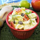 Waldorf Salad III - This creamy Waldorf Salad boasts the addition of golden raisins, fluffy whipped cream and tangy lemon and orange juices to the usual apples, celery and mayonnaise.
