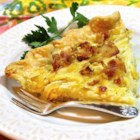 Onion Tart - This simple tart of cooked onions and bacon can be served warm or cold.