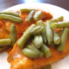 Super Special Chicken - Baking chicken and green beans together with a sauce made of French dressing, chili seasoning, dried onion, and parsley makes a quick and easy dinner in one dish.