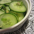 Refreshing Korean Cucumber Salad - Thinly sliced cucumbers are tossed in a spicy, sesame seed dressing in this Korean cucumber salad that is refreshing side dish.
