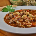 Italian Sausage and Tomato Soup - This easy tomato soup is thick with turkey sausage, cannellini beans, and pasta. It's sure to warm your belly on a cold night.