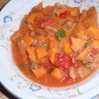 Vegan African Stew - This stew recipe uses peanut butter, apple juice, and tomatoes to flavor the abundance of yams, cabbage, onion, and bell pepper stewing within.
