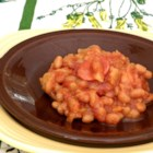 Tropical Island Baked Beans - This baked bean and smoked sausage casserole recipe uses canned crushed pineapple for a taste of the tropics in your side dish.