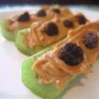 Cinnamon Ants on Sticks - Cinnamon adds a flavor twist to a favorite snack kids love to make themselves with celery sticks, peanut butter and raisins.