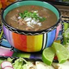 Carne en su Jugo (Meat in its Juices) - Small pieces of flank steak are simmered with a tomatillo sauce and mixed with pinto beans and crispy crumbled bacon in this recipe from Guadalajara, Mexico.