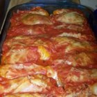 Ukrainian Cabbage Rolls - Rice wrapped in steamed cabbage leaves, covered with tomato sauce, and baked.