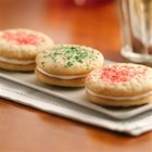 Holiday Sandwich Cookies - Sparkly, sweet and oh-so-festive, these holiday sandwich cookies start with Pillsbury(R) Ready-to-Bake!(TM) refrigerated cookies, so they couldn't be easier!