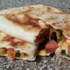Andouille and Poblano Quesadillas - Fiery andouille sausage and spicy poblano peppers are tamed by lots of colby cheese in these tasty Tex-Mex quesadillas.