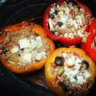 Nick's Feta and Artichoke Stuffed Peppers - Artichoke hearts, feta cheese, and brown rice make these stuffed peppers a little different than the typical recipe.