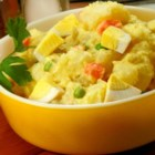 Ima's Potato Salad - Chopped Israeli-style pickles and peas and carrots liven up this mayonnaise-based potato salad.