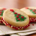 Christmas Tree Sandwich Cookies - Right-side up or upside down, there's a cute Christmas tree shape on both sides of these easy cookie sandwiches!