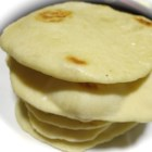 Chef John's Pita Bread - Mix up a simple dough, let it rise, and experience the true taste of homemade pita breads from your own kitchen.