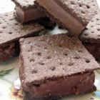 Frozen Peanut Butter Pudding Squares - Chocolaty peanut butter goodness layered between graham crackers and frozen is the result of this easy-to-follow recipe.