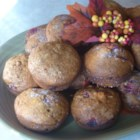 Cranberry Pumpkin Muffins - Orange zest adds a layer of flavor to these cranberry and pumpkin muffins.
