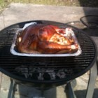 Grilled Turkey - Great grilled turkey! My grill is an old one that has a hinged top. I open all of the vents and prop the lid open about 2 to 3 inches with a stick...man does it get hot! Do not spill the juices and wine on the coals, as they are extremely flammable.
