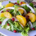 Pretty Pomegranate Salad - Super simple and delicious, this pomegranate, arugula, and spinach salad is a beautiful addition to any meal.