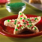 Christmas Star Treats(TM) - Your kids can help make these simple star shapes by decorating them with red and green candies.