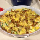 Zucchini Casserole II - This is a tasty way to use up your bumper crop of zucchini. It's a casserole that sandwiches a rich zucchini mixture between two layers of herb-seasoned stuffing.