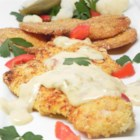 Queso Catfish - Crisply breaded catfish is roasted in the oven, and served with a chipotle cheese sauce. A deliciously crunchy and spicy way to serve catfish inspired by a similar dish I had in Beaumont, TX.