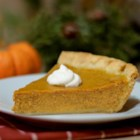 Pumpkin Pie II - Why resist? You know you can't make it through Thanksgiving without a slice of moist, delicious pumpkin pie smothered with whipped topping! Make sure the edges of your crust are high, as this recipe creates a generous amount of filling.