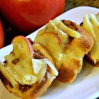 Fig and Brie Crostini - Nicely spiced fig spread is layered on toasted French bread with Brie cheese and apples for impressive and tasty crostini perfect for parties.