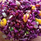 Purple Cabbage Salad - Red cabbage, green onion, mandarin oranges, dried cranberries, and pine nuts make up an interesting and colorful salad.