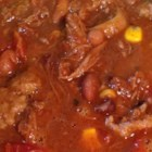 Chili With Pulled Beef & Pork for a Crowd - Serve a simple bowl of chili and guests will be content. Zip in fun, colorful condiments and you've got a party. The chili yields about 5 quarts without the beans, and may be cooled, covered, and refrigerated or up to 3 days and reheated when ready to serve.