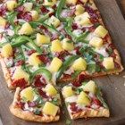 Contadina(R) Hawaiian-Style Pizza - Crumbled bacon, pineapple chunks, bell pepper strips and prepared pizza sauce make a quick and tasty pizza.