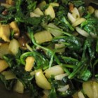 Cameroonian Fried Spinach - Spinach, onions and mushrooms are fried together and flavored with garlic in this super-easy side dish. The onions need to stay in big pieces, as you eat this dish with your fingers.