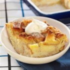 Spiced Layered Banana Bread Pudding - A layer of banana slices dresses up a warmly-spiced bread pudding. This is lovely as a brunch casserole or a simple holiday dessert.
