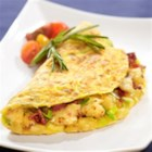 Bacon, Leek and Potato Omelette - This herbed omelette is rich with crisp bacon, grated golden potato and delicate leeks, delicious any time.