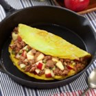 Family Style Apple and Sausage Omelette - This large family style omelette is great to serve for brunch or any get together. Spice it up with a variety of fresh sausages from your local grocer.