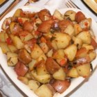 Roasted Potatoes with Tomatoes, Basil, and Garlic - Potatoes and tomatoes are roasted in olive oil with garlic and herbs.