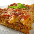 Tofu Lasagna - Tofu is combined with eggs, spaghetti sauce, mozzarella cheese and spices.  The mixture is layered with lasagna noodles and topped with more cheese.