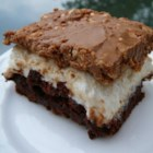 Brownie-Mallow Bars - Melted marshmallows are sandwiched between a layer of brownies and chocolate-peanut butter crispy rice cereal in this decadent dessert.
