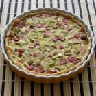 Rhubarb Custard Pie IV -  Fresh rhubarb is cut into small pieces and piled into a prepared crust. A creamy custard filling is stirred up with eggs, a bit of milk, flour, sugar and nutmeg, and then it 's poured over the rhubarb. The pie is slipped into the oven for an hour until the custard is set. Cool it slightly before serving.