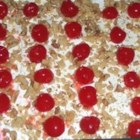 Southern Style Banana Split Cake - Graham cracker crumbs, sweetened cream cheese, crushed pineapple, and maraschino cherries are layered with whipped topping in this easy no-bake dessert.