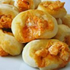 Buffalo Chicken Bites - Pan-fried buffalo chicken bites are served with a garlic hot sauce and will be in high demand at your next football-watching gathering.