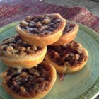 Pecan Cranberry Butter Tarts - Pecan and cranberry butter tarts are a festive dessert to serve on Thanksgiving and during the holidays and will disappear quickly.
