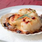 How to Make Coquilles Saint-Jacques  - Tender, plump sea scallops are served on real scallop shells with sauteed mushrooms, a creamy sauce, and a topping of Gruyere cheese for a fancy appetizer or small plate that's surprisingly easy to make.