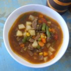 Vegetable Beef Soup III - Beef stew meat is slowly simmered with tomato-vegetable juice cocktail, onion, chili powder and Worcestershire and then potatoes, carrots and celery are added at the end and cooked until just tender.