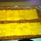 Dorito(R) Casserole - Cooked ground beef, cream of chicken soup, enchilada sauce, and milk get mixed together and poured over crushed, flavored tortilla chips in this combination of snack and Mexican foods.