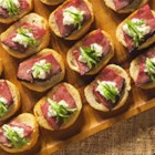 Crostini with Beef Tenderloin and Horseradish - Toasted bread rounds are topped with roast beef, zesty horseradish sauce, and curly frisee for a quick and delicious appetizer.