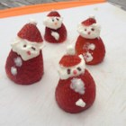 Mini Strawberry Santas - Adorable little Santas made with strawberries, whipped cream, and chocolate sprinkles will have your guests gathering around the Christmas dessert table.